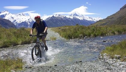 Cyclist crossing Conners Creek on the Rainbow high country station